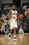 Rodney Stuckey of the Indiana Pacers drives against the Milwaukee Bucks at Bankers Life Fieldhouse on November 4 2014 in Indianapolis Indiana NOTE TO...