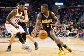 Rodney Stuckey of the Indiana Pacers drives around Iman Shumpert of the Cleveland Cavaliers during the first half at Quicken Loans Arena on March 20...