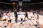 Rodney Stuckey of the Indiana Pacers drives to the basket against Brendan Haywood and Kevin Love of the Cleveland Cavaliers during the game at Cintas...