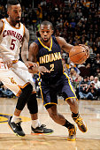 Rodney Stuckey of the Indiana Pacers drives to the basket against the Cleveland Cavaliers during the game on March 20 2015 at Quicken Loans Arena in...