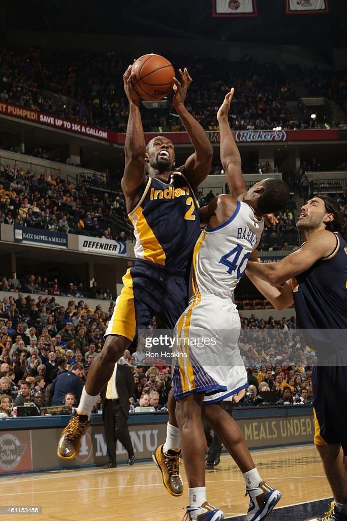 Rodney Stuckey of the Indiana Pacers goes up for a shot against the Golden State Warriors on February 22 2015 at Bankers Life Fieldhouse in...
