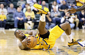 Rodney Stuckey of the Indiana Pacers grabs a loose ball during the game against the Philadelphia 76ers at Bankers Life Fieldhouse on March 1 2015 in...
