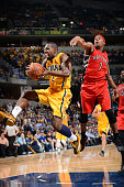 Rodney Stuckey of the Indiana Pacers grabs the rebound against Kyle Lowry of the Toronto Raptors during the game on March 16 2015 at Bankers Life...