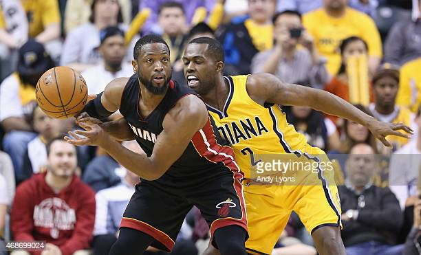 Rodney Stuckey of the Indiana Pacers guards Dwyane Wade of the Miami Heat at Bankers Life Fieldhouse on April 5 2015 in Indianapolis Indiana Tonight...