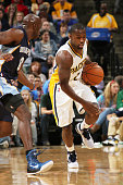 Rodney Stuckey of the Indiana Pacers handles the ball against the Memphis Grizzlies at Bankers Life Fieldhouse on October 31 2014 in Indianapolis...