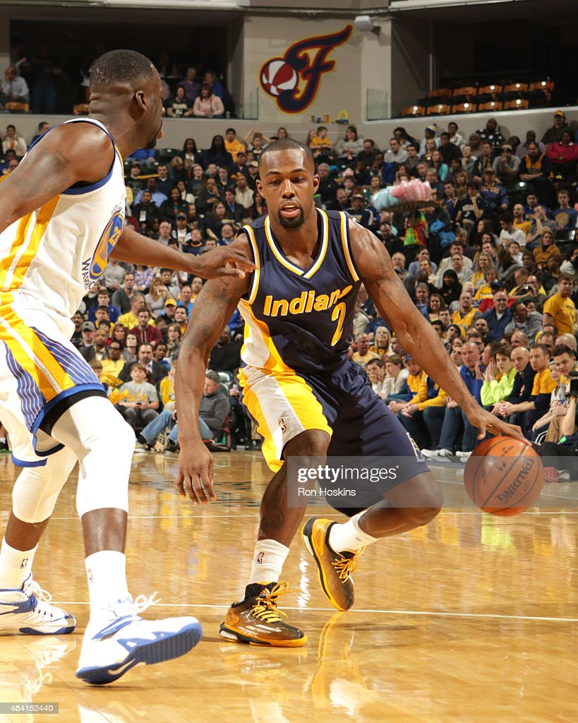Rodney Stuckey of the Indiana Pacers handles the ball against the Golden State Warriors on February 22 2015 at Bankers Life Fieldhouse in...
