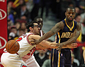 Rodney Stuckey of the Indiana Pacers passes around Kirk Hinrich of the Chicago Bulls at the United Center on March 18 2015 in Chicago Illinois NOTE...