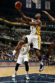 Rodney Stuckey of the Indiana Pacers shoots against the Phoenix Suns on November 22 2014 at Bankers Life Fieldhouse in Indianapolis Indiana NOTE TO...