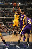 Rodney Stuckey of the Indiana Pacers shoots against Wesley Johnson of the Los Angeles Lakers on December 15 2014 at Bankers Life Fieldhouse in...
