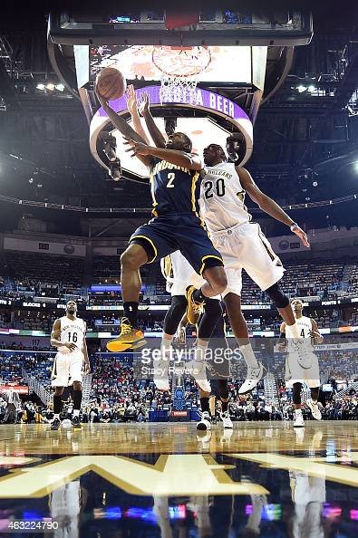 Rodney Stuckey of the Indiana Pacers takes a shot against Quincy Pondexter of the New Orleans Pelicans during the second half of a game at the...