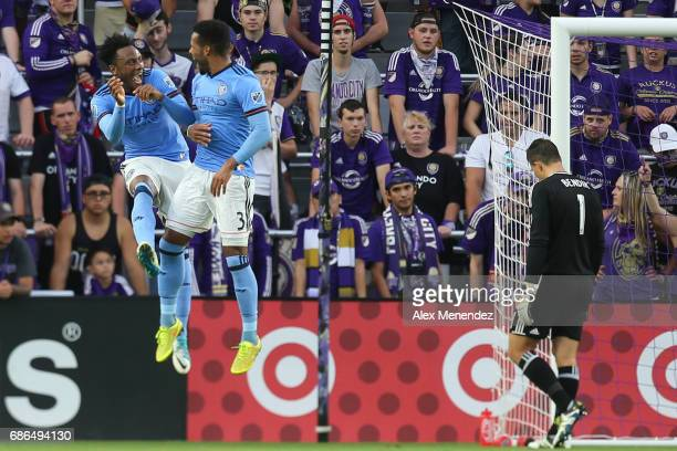 Rodney Wallace of New York City FC celebrates his goal with Ethan White of New York City FC as Joseph Bendik of Orlando City SC looks away during a...