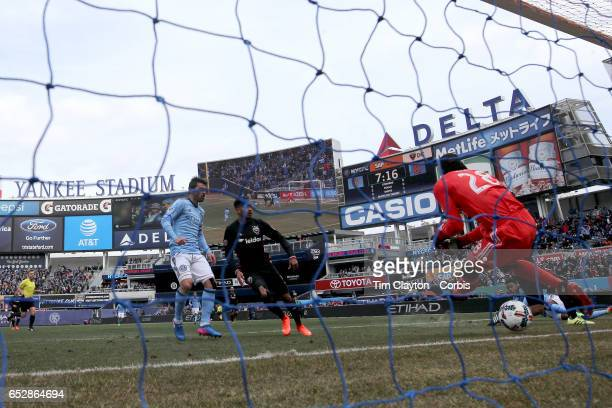 Rodney Wallace of New York City FC scores New York's opening goal beating goalkeeper Bill Hamid of DC United after a shot from Jack Harrison of New...