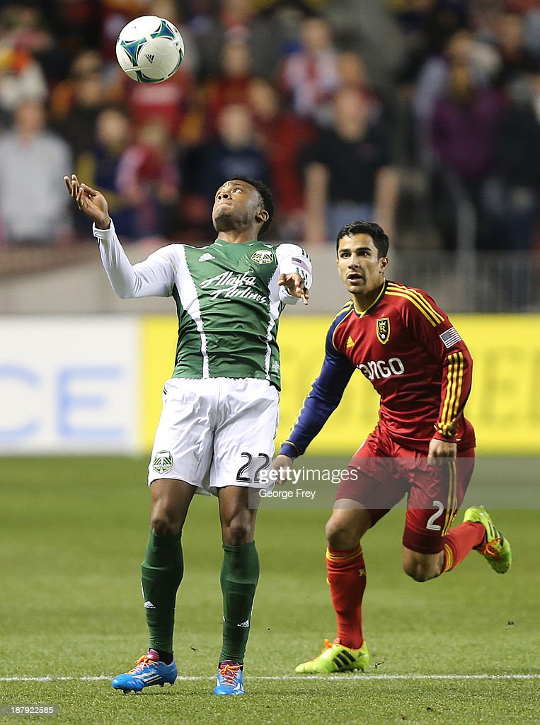 Rodney Wallace of the Portland Timbers heads the ball during the first half of the Western Conference Championship Leg 1 as Tony Beltran of Real Salt...