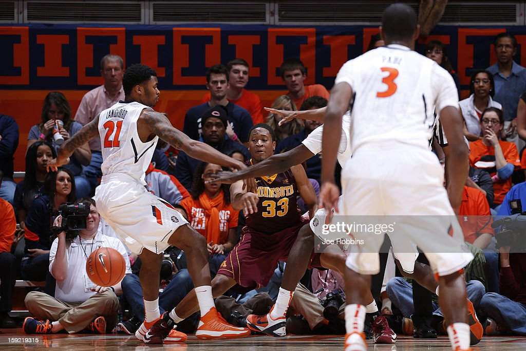 Rodney Williams #33 of the Minnesota Golden Gophers passes the ball against pressure from Devin Langford #21 of the Illinois Fighting Illini during the game at Assembly Hall on January 9, 2013 in Champaign, Illinois. Minnesota won 84-67.