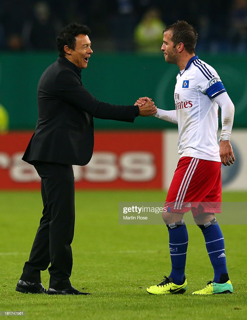 Rodolfo Cardoso (L), head coach of Hamburg celebrate with rafael van der Vaart after the DFB Cup second round match between Hamburger SV and Greuther Fuerth at Imtech Arena on September 24, 2013 in Hamburg, Germany.