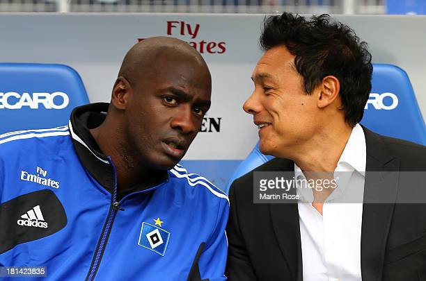 Rodolfo Cardoso interims coach of Hamburg talks to Otto Addo before the Bundesliga match between Hamburger SV and Werder Bremen at Imtech Arena on...