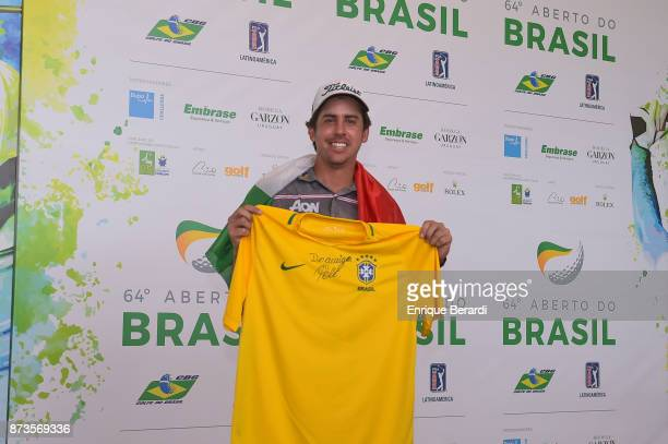 Rodolfo Cazaubon of Mexico hold a tshirt signed by Pele during the final round of the PGA TOUR Latinoamerica 64 Aberto do Brasil at the Olympic Golf...