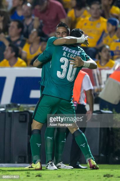 Rodolfo Cota goalkeeper of Chivas celebrates with teammate Miguel Jimenez after teammate Rodolfo Pizarro scored his team's second goal during the...