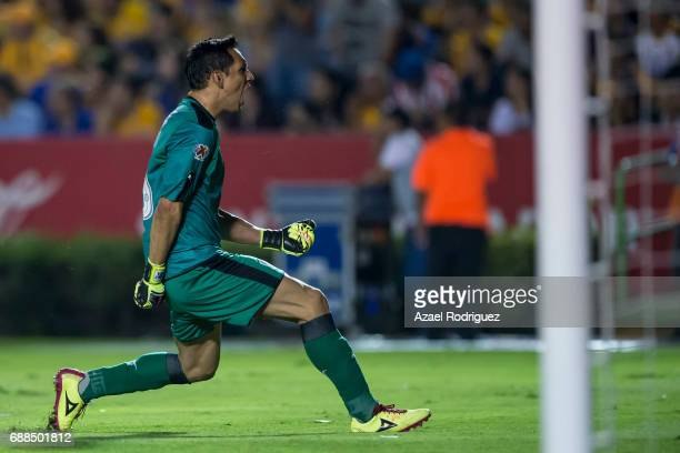 Rodolfo Cota goalkeeper of Chivas reacts after teammate Alan Pulido scored his team's first goal during the Final first leg match between Tigres UANL...
