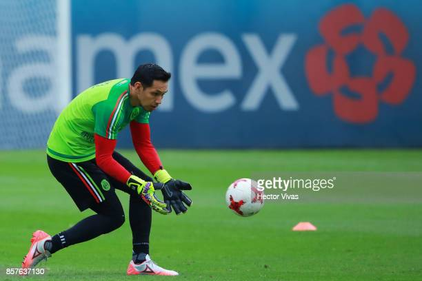 Rodolfo Cota goalkeeper of Mexico catches the ball during a Mexico's National Team training session ahead of the Qualifier match against Trinidad...