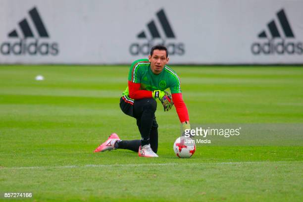 Rodolfo Cota goalkeeper of Mexico holds the ball during a Mexico's National Team training session ahead of the Qualifier match against Trinidad...