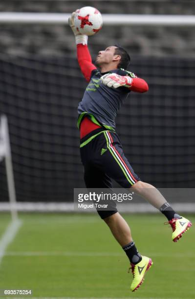 Rodolfo Cota jumps for the ball during a Mexico national team training session at CAR on June 07 2017 in Mexico City Mexico