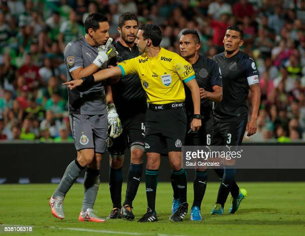 Rodolfo Cota of Chivas appeals to referee Cesar Arturo Ramos during the sixth round match between Santos Laguna and Chivas as part of the Torneo...