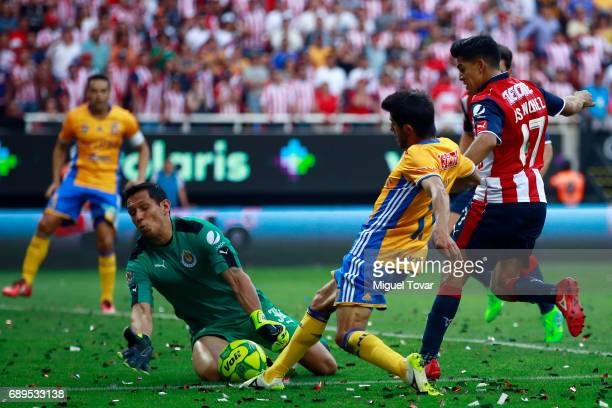 Rodolfo Cota of Chivas blocks a goal of Damian Alvarez of Tigres during the Final second leg match between Chivas and Tigres UANL as part of the...