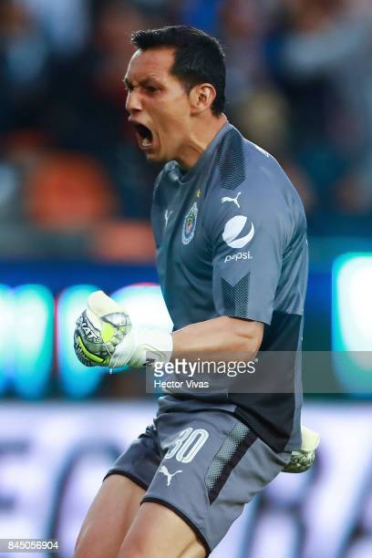 Rodolfo Cota of Chivas celebrates after Michael Perez scored the first goal of his team during the 8th round match between Pachuca and Chivas as part...