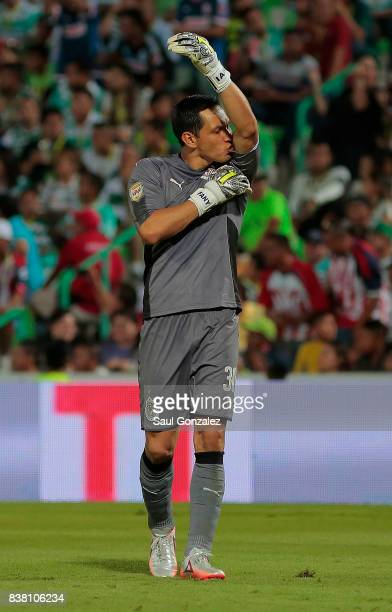 Rodolfo Cota of Chivas celebrates the first goal of his team scored by his teammate Angel Zaldívar during the sixth round match between Santos Laguna...
