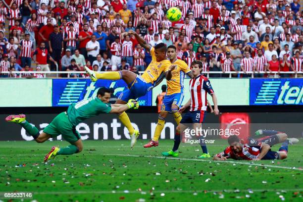Rodolfo Cota of chivas fights for the ball with Luis Advincula of Tigres during the Final second leg match between Chivas and Tigres UANL as part of...