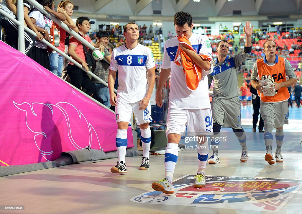 Rodolfo Fortino Alex Merlim of Italy and other team mates leave dejected the pitch after loosing the FIFA Futsal World Cup SemiFinal match between...
