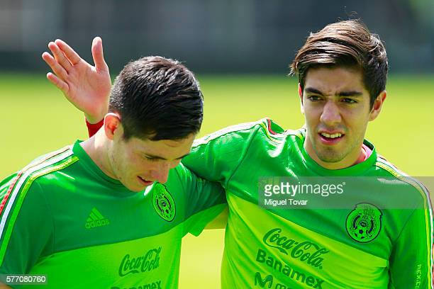 Rodolfo Pizarro and Marco Bueno of Mexico joke during a training session ahead of the friendly match between Mexico and Argentina at CAR on July 18...