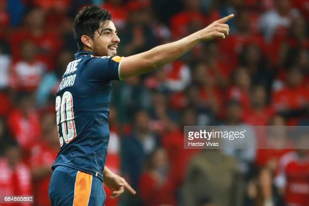 Rodolfo Pizarro of Chivas celebrates after scoring the first goal of his team during the semifinals first leg match between Toluca and Chivas as part...