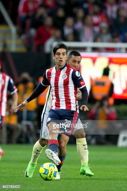Rodolfo Pizarro of Chivas fights for the ball with Gil Buron of America during the 7th round match between Chivas and America as part of the Torneo...