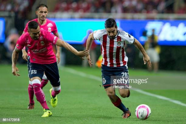 Rodolfo Pizarro of Chivas fights for the ball with Mario Osuna of Morelia during the 13th round match between Chivas and Morelia as part of the...
