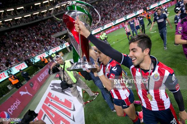 Rodolfo Pizarro of Chivas lifts the trophy after winning the final match between Chivas and Morelia as part of the Copa MX Clausura 2017 at Chivas...
