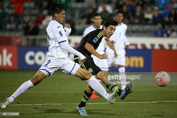 Rodolfo Pizarro of Mexcio takes a shot on goal against Jhontan Paz of Honduras during 2015 CONCACAF Olympic Qualifying at Dick's Sporting Goods Park...