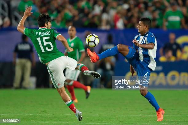 Rodolfo Pizarro of Mexico and Bryan Acosta of Honduras fight for the ball during the CONCACAF Gold Cup 2017 quarterfinal match between Mexico and...