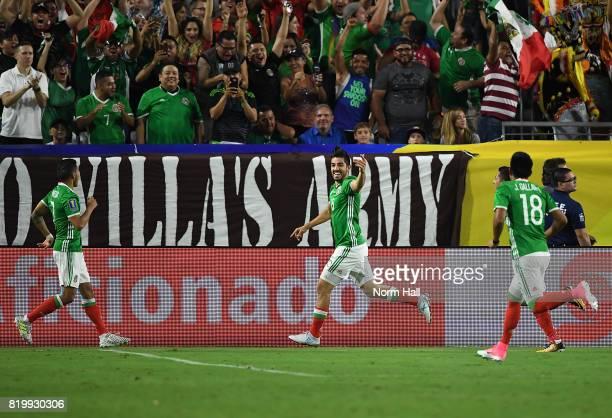Rodolfo Pizarro of Mexico and teammates Orbelin Pineda and Jesus Gallardo celebrate a first half goal against Honduras in a quarterfinal match during...