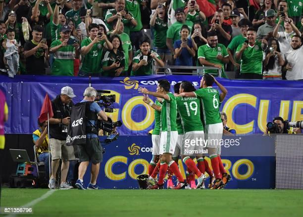 Rodolfo Pizarro of Mexico and teammates Orbelin Pineda Edson Alvarez Jesus Gallardo and Angel Sepulveda celebrate a first half goal against Honduras...