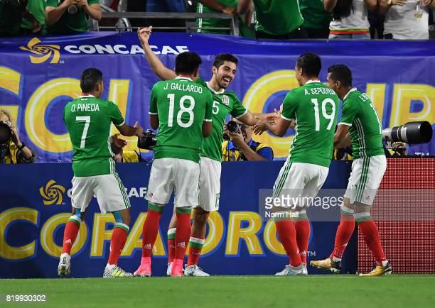 Rodolfo Pizarro of Mexico and teammates Orbelin Pineda Jesus Gallardo and Angel Sepulveda celebrate a first half goal against Honduras in a...