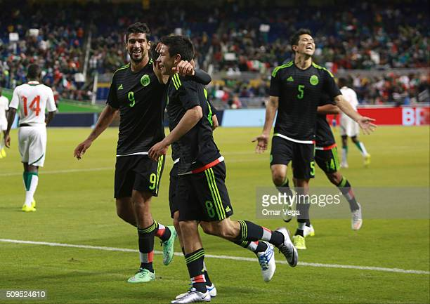 Rodolfo Pizarro of Mexico celebrates with his teammates after scoring the second goal of his team during the international friendly match between...