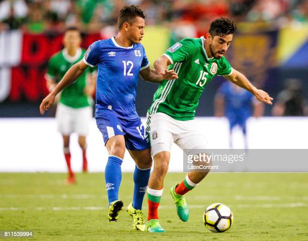 Rodolfo Pizarro of Mexico competes for the ball with Narciso Orellana of El Salvador during a Group C match between Mexico and El Salvador as part of...