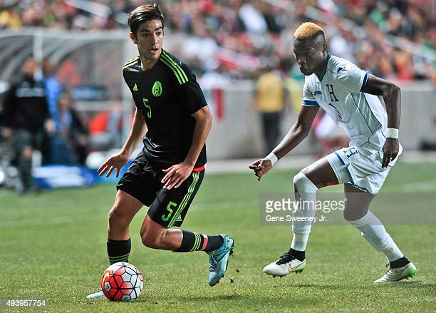 Rodolfo Pizarro of Mexico directs the ball away from Kevin Alvarez of Honduras during the final CONCACAF Olympic Qualifying match at Rio Tinto...