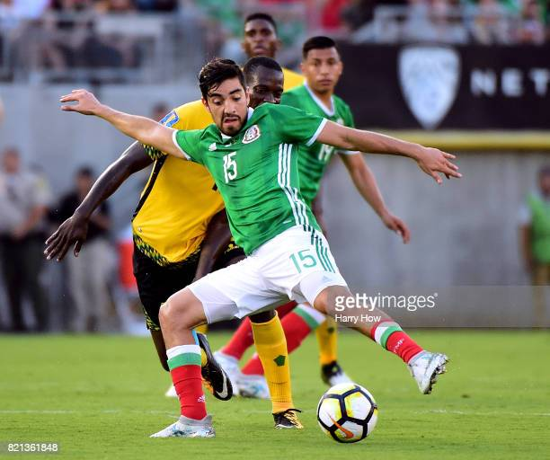 Rodolfo Pizarro of Mexico keeps the ball from JeVaughn Watson of Jamaica during a 10 Jamaican win in the CONCACAF 2017 semifinal at Rose Bowl on July...