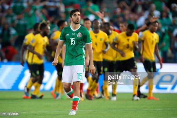 Rodolfo Pizarro of Mexico looks on as players of Jamaica celebrate after qualifying to the final during a match between Mexico and Jamaica as part of...