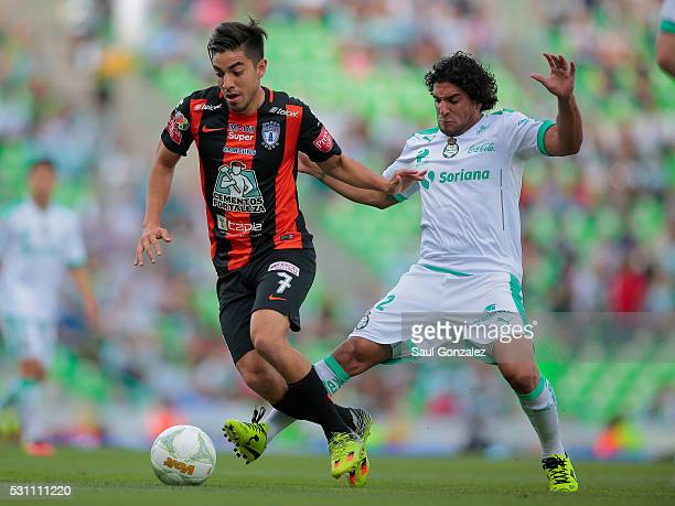 Rodolfo Pizarro of Pachuca fights for the ball with Martin Bravo of Santos during the quarter finals first leg match between Santos Laguna and...