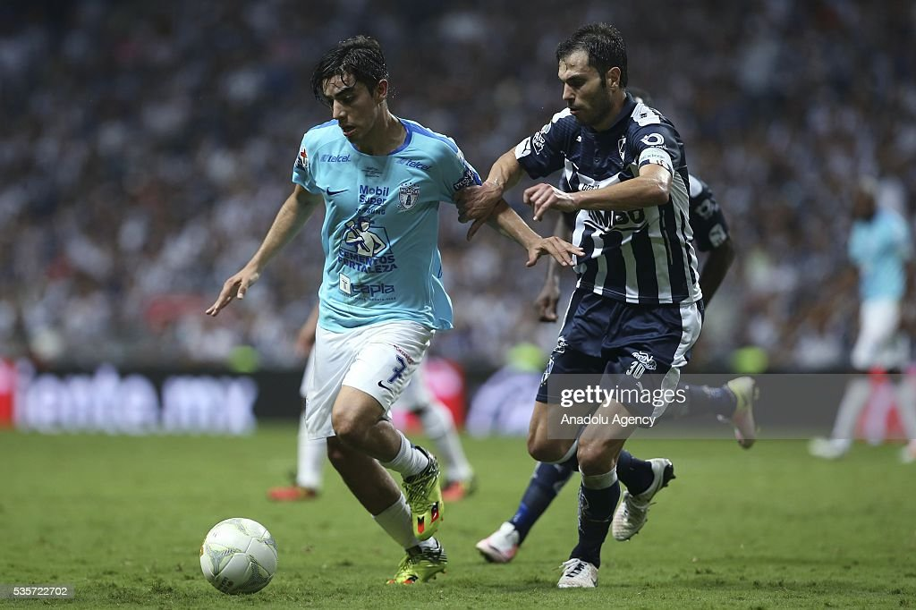 Rodolfo Pizarro (L) of Pachuca in action against Jose Maria Basanta (R) of Monterrey during the Final second leg match of the Clausura 2016 Liga MX between Monterrey and Pachuca, at BBVA Bancomer Stadium, in Monterrey, Mexico on May 29, 2016.