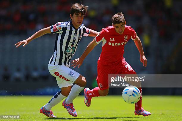Rodolfo Pizarro of Pachuca struggles for the ball with Isaac Brizuela of Toluca during a match between Toluca and Pachuca as part of 5th round...